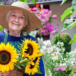Elderly woman showing gardening as a great hobby for seniors with mobility issues